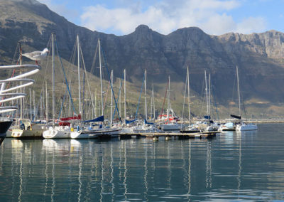 Chapmans Peak from Hout Bay harbour